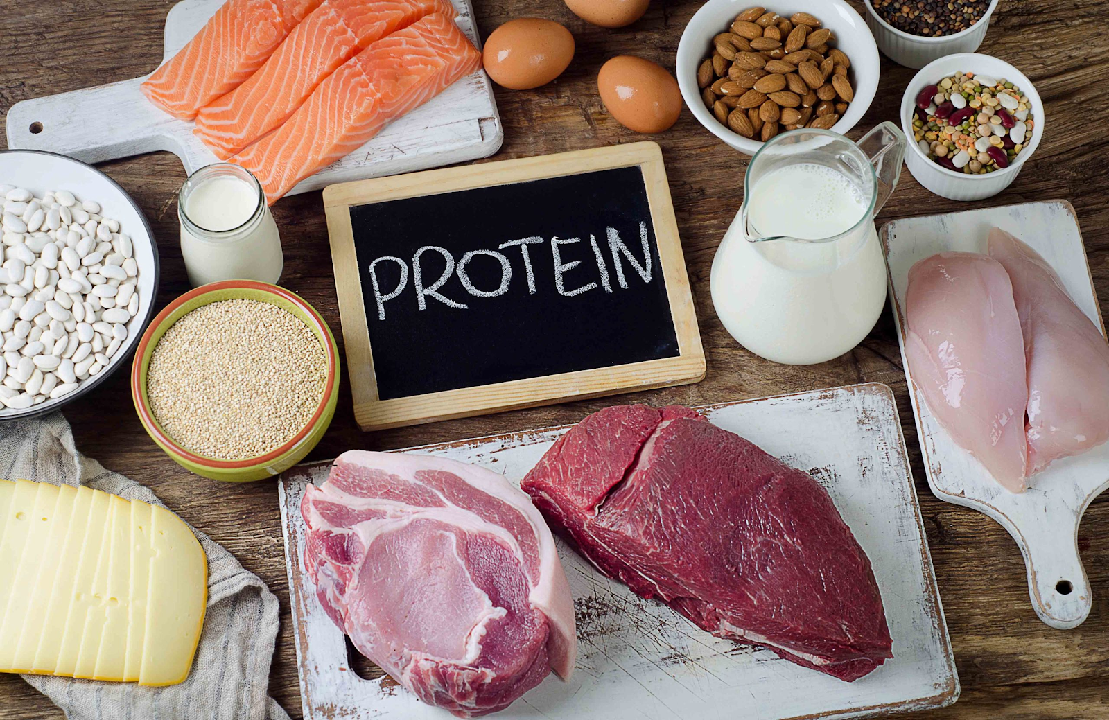 photo with chicken breast, steak, milk, seeds and fish grouped together