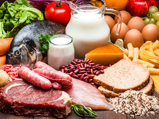 a photo showing meat, fish, steak, milk, bread, seeds, carbs, eggs and lettuce post workout nutrition
