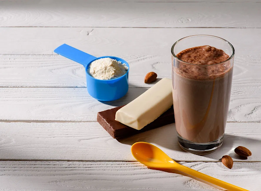 chocolate protein shake made from scratch in a clear cup